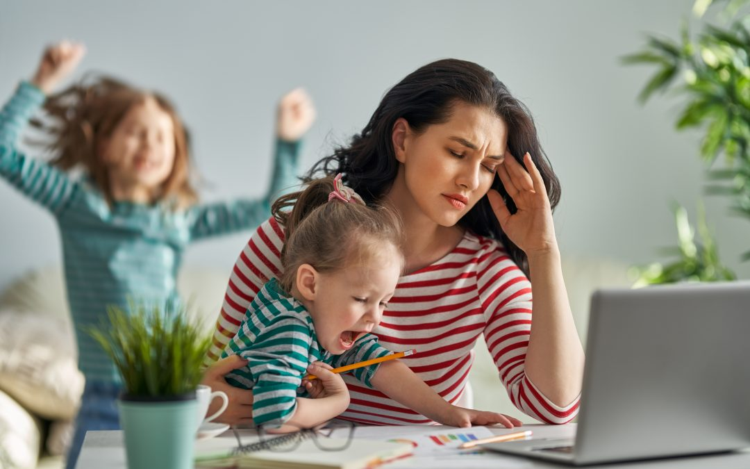 mother distracted by children while working from home